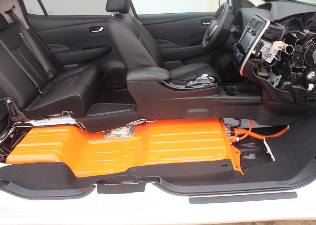 "The battery in the Nissan Leaf is mounted under the floor, resulting in a low center of gravity and excellent handling. (Source: ""2013 Nissan Leaf cutaway (2)"" by Norsk Elbilforening, Licensed under CC BY 2.0 via Wikimedia Commons)"