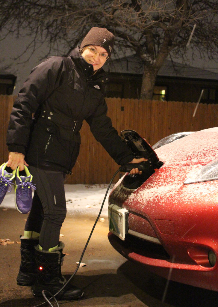Eva with the Leaf, beating the cold with a battery-powered car and battery-heated boots on her feet.